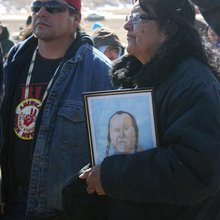Gunfire, chants mark Wounded Knee anniversary