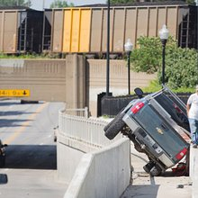 Crashed truck removed from between guardrail, wall in North Lawrence