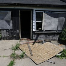 Vacant houses remain open where slain women found
