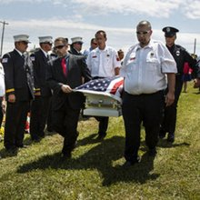 9-year-old Justin Borrell Jr. gets a fireman's sendoff