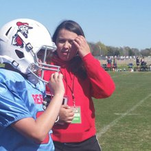 Female coach taking Flower Mound youth football team to higher ground