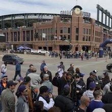 Denver police investigating video of cop shoving Rockies fan