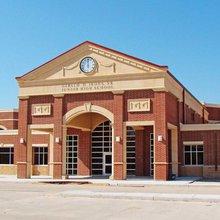 Why do suburban schools look alike?
