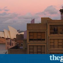 The man behind the most famous sign seen from Sydney's Harbour Bridge