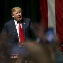 Trump warns Clinton to be careful in using woman 'card'