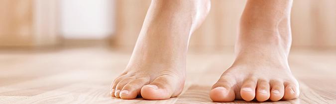 A person walking barefoot inside