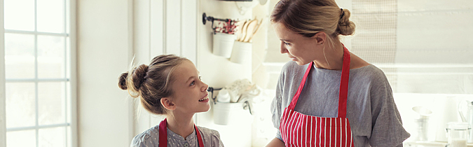Photo of a mother and child baking together