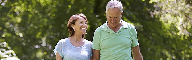 Photo of a couple walking through a park.
