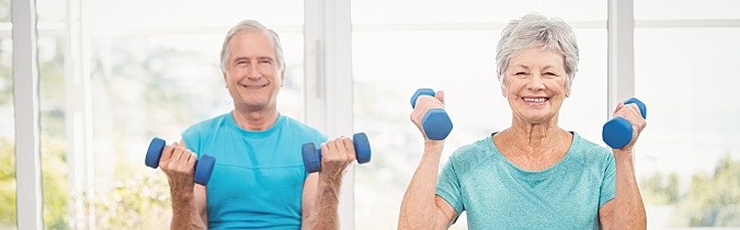 Photo of a man and woman lifting weights.