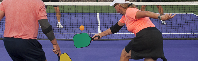 Photo of older adults playing pickleball