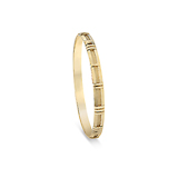 A GOLD `ATLAS` BANGLE, BY TIFFANY AND CO. -    - Fine Jewels and Objets d'Art