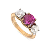 A RUBY AND DIAMOND THREE-STONE RING -    - Auction of Fine Jewels & Watches