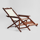 A PERIOD CAMPAIGN LOUNGE CHAIR -    - Travel and Leisure Auction