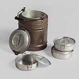 A VINTAGE TIFFIN CARRIER -    - Travel and Leisure Auction