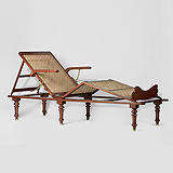AN ELEGANT CAMPAIGN DAY BED -    - Travel and Leisure Auction