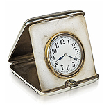 A STERLING SILVER AND LEATHER TRAVEL CLOCK -    - Travel and Leisure Auction