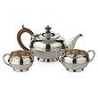 A SILVER TEA SET, S. W. SMITH & CO. - 24-Hour Online Auction: Elegant Design