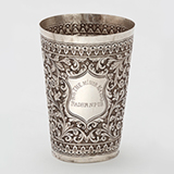 A CHASED KUTCH SILVER TUMBLER, OOMERSI MAWJI -    - Online Auction of Fine Jewels and Silver