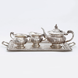 AN IMPORTANT 'SWAMI' SILVER THREE PIECE TEA SERVICE WITH TRAY -    - Online Auction of Fine Jewels and Silver