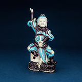 TURQUOISE AND AUBERGINE COLOURED PORCELAIN FIGURE OF CELESTIAL GUARDIAN -    - Asian Art