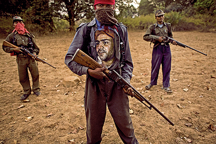 A Maosist Rebel Wearing a Cricketer Virender Sehwag Shirt Patrols in the Dandakaranya Forests
