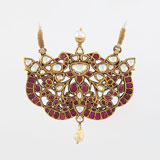 -AN IMPORTANT DIAMOND AND RUBY PENDANT