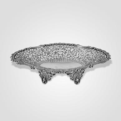Cutch Pierced Oval Dish with Peacock Feet by Oomersi Mawji