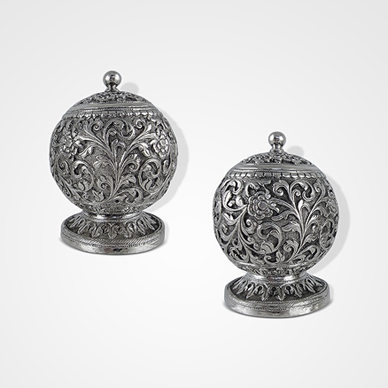Cutch Pair Round Pepper Pots by Oomersi Mawji