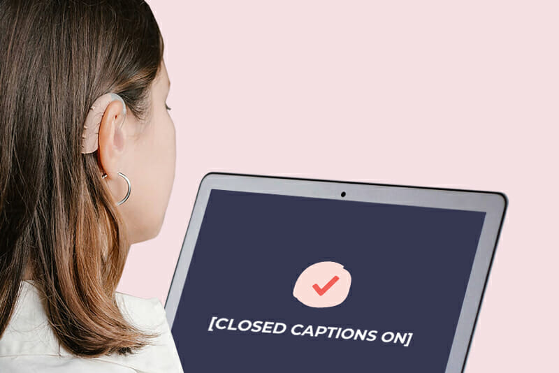 image showing a woman with a hearing aid watching a video with closed captions