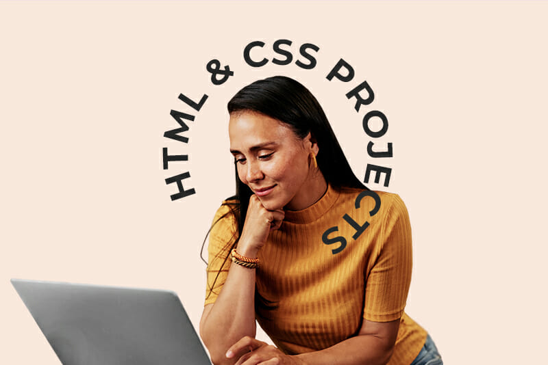 """A 40 year old woman looking at a laptop with """"html and css projects"""" over her head"""