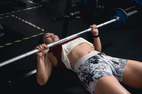 Flat barbell bench press - Top 7 Strength Training Exercises For Women