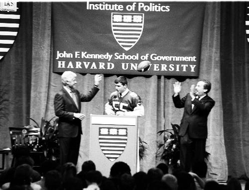 Former President BILL CLINTON tosses to University President Lawrence H. Summers.