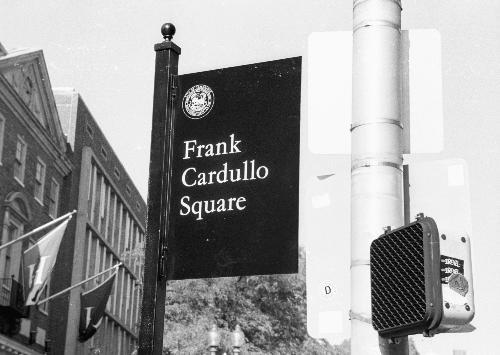 A newly displayed sign in Harvard Square honors the late Frank N. Cardullo, who worked in the area for nearly 50 years.