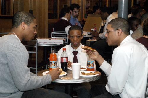 Members of the Harlem Boys Choir enjoy refreshments at their welcoming ceremony in Loker Commons yesterday. They will perform in Sanders Theater Friday night.