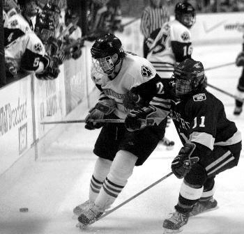 Junior forward TIM PETTIT, shown here in earlier action, registered three assists and a goal for the weekend.
