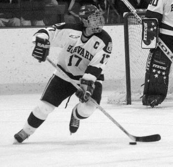 Captain and forward DOMINIC MOORE (17) notched two goals and two assists in the Harvard men's hockey team's roadtrip to Dartmouth and Vermont. The Crimson adjusted well to lineup changes due to the flu-like symptons that have plagued the team all week.