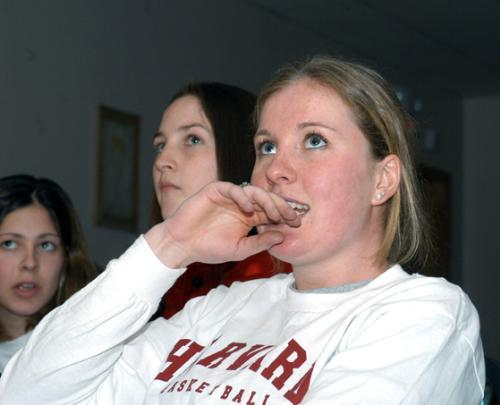 Junior TRICIA TUBRIDY (right), with teammates sophomore KATIE MURPHY (middle) and junior BEV MOORE (left) wait to hear of the women's basketball team's NCAA site and opponent