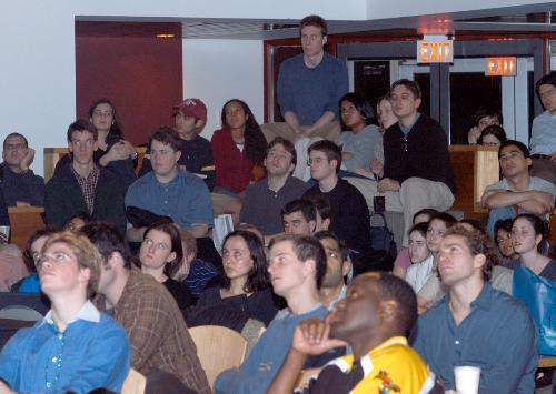 Students watch President Bush's speech in the ARCO Forum last night.