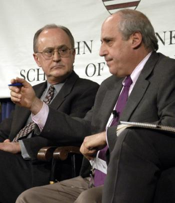 Hours away from the official outbreak of military action, former Assistant Secretary-General of the U.N. JOHN RUGGIE (left) and Institute of Politics Director DAN GLICKMAN debate war on Iraq.
