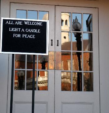 At the doors of the First Unitarian Universalist Church in Cambridge yesterday, a sign invites visitors to light candles in hope of peace.