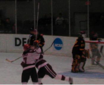 Junior LAUREN McAULIFFE (R) hugs captain KALEN INGRAM after scoring to put the Harvard women's hockey team ahead 2-0.