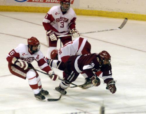 Freshman CHARLIE JOHNSON (19), who saw regular time with the second power play unit, is tripped up by Terrier stick work in NCAAs.