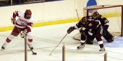 Sophomores NOAH WELCH (5) and DOV GRUMET-MORRIS (30), shown here against BU, combined to slow down Dartmouth's top-line forwards and propel the Crimson into the ECAC title game against Cornell.