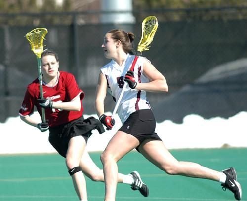 Sophomore attack CASEY OWENS (R) scored a goal against California in the Harvard women's lacrosse team's 7-6 loss.
