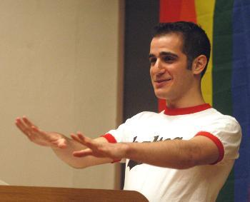 """OUSSAMA ZAHR '03 speaks during a meeting in Sever Hall Friday to kick off """"Gaypril,"""" a month of events that will include celebrations of gay pride and a day of silence to promote awareness of homophobia."""