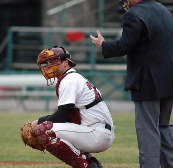 Senior BRIAN LENTZ, shown in earlier action, and the Harvard baseball team split its Ivy-opening doubleheaders this weekend.