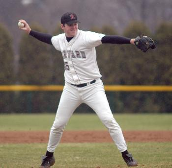 Senior BRENDAN REED, shown pitching against Rhode Island, is one of the six senior pitchers on the Harvard squad.