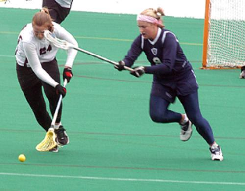 Freshman defenseman BRIDGET DRISCOLL (24) collects one of two ground balls she picked up in Harvard's 16-5 loss to Yale.