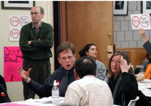 Cambridge public school parents agonize over the future of the school system in the minutes leading up to a tense six-hour-long debate last night. The school commitee voted to close two public elementary schools.