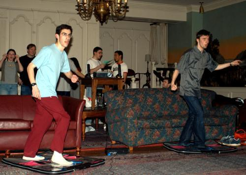 JASON T. ABALUCK '06 (left) and LUKASZ STROZEK '06, one of the winners, compete in the Dance, Dance Revolution contest in the Lowell House Junior Common Room Saturday.